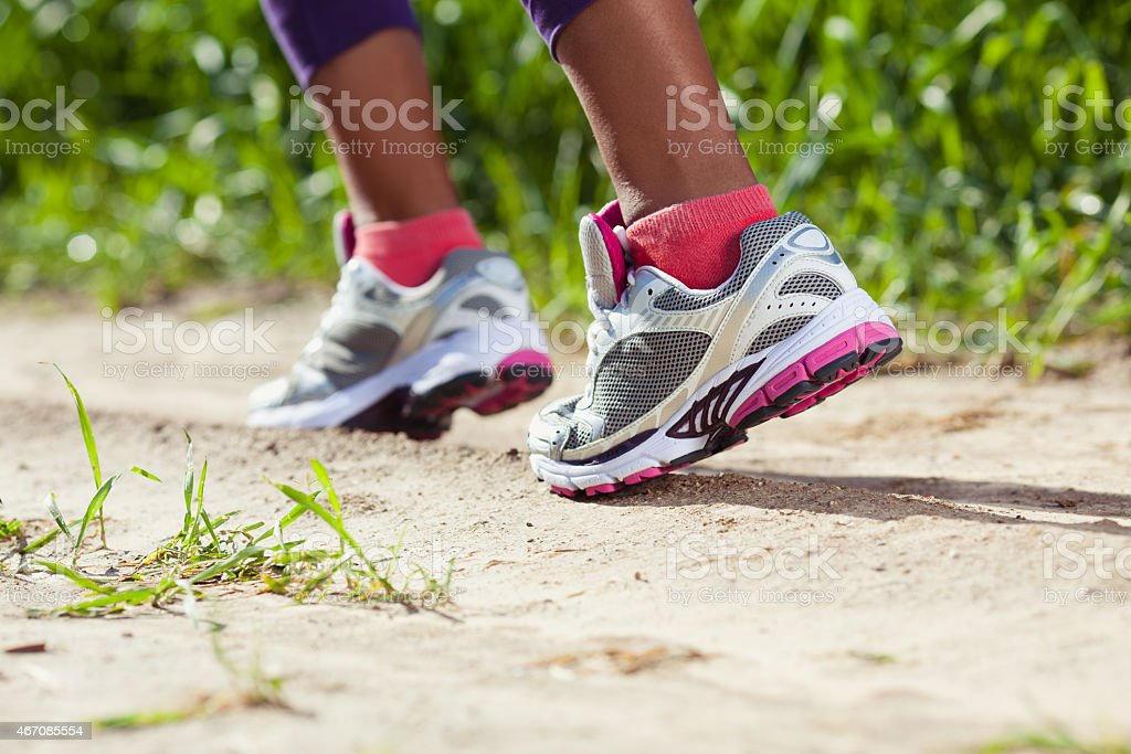 Walking/running legs sport shoes. stock photo