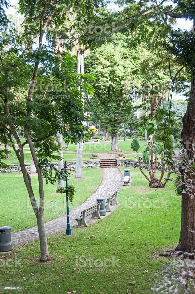 Walkway and benches in Hamilton, Bermuda, Victoria Park. stock photo