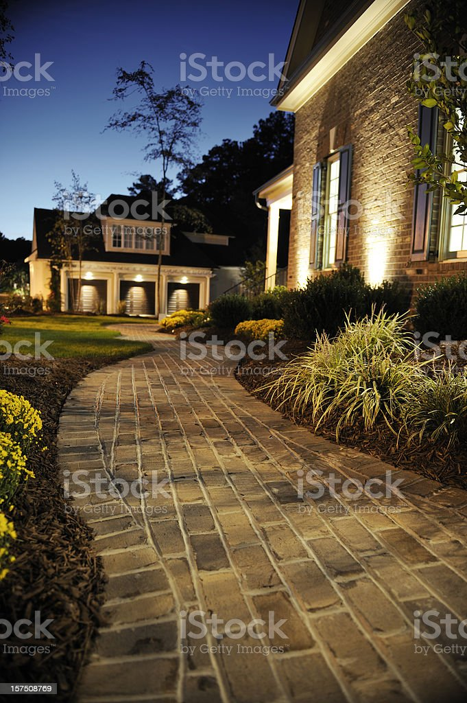 Walkway in front of luxury home stock photo