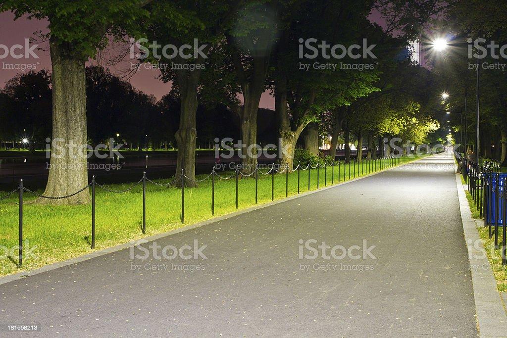 Walkway next to Reflecting pool at night in Washington DC stock photo