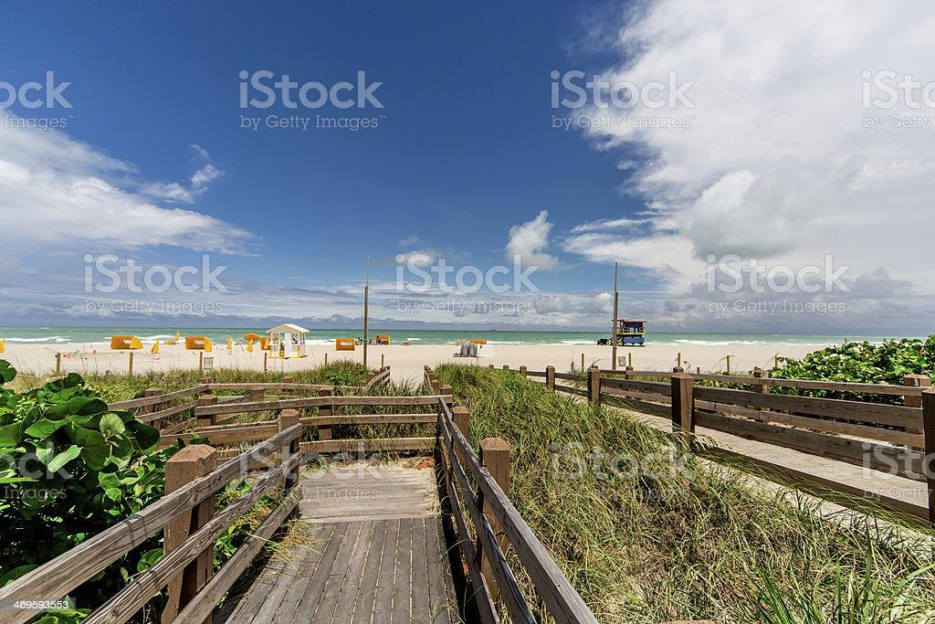 walkway to peaceful beach scene stock photo