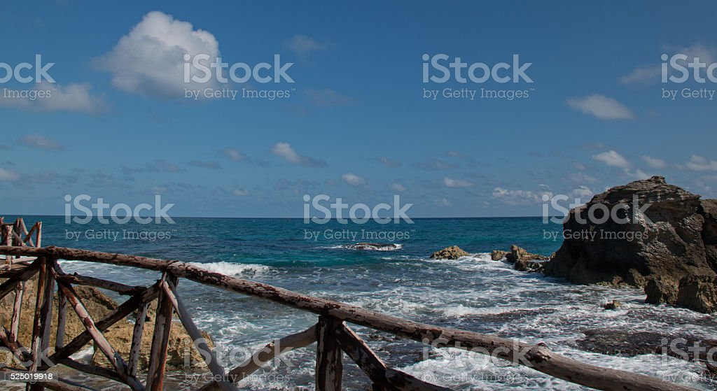 Isla Mujeres - Looking east over the wooden rail on the walkway and...
