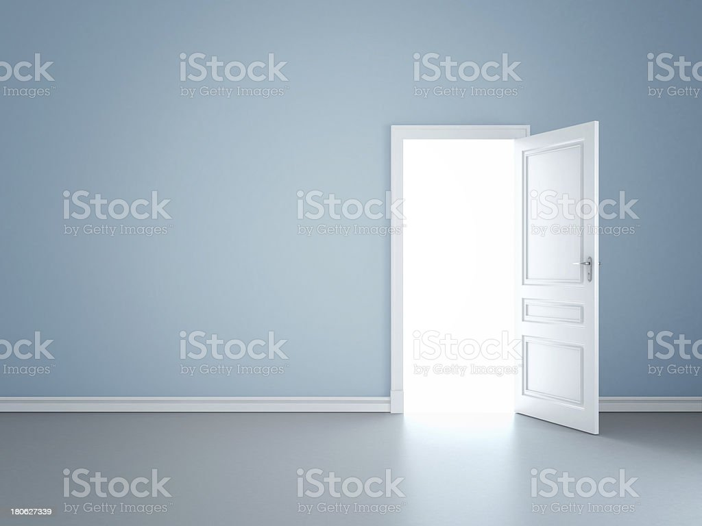 wall and opened door stock photo