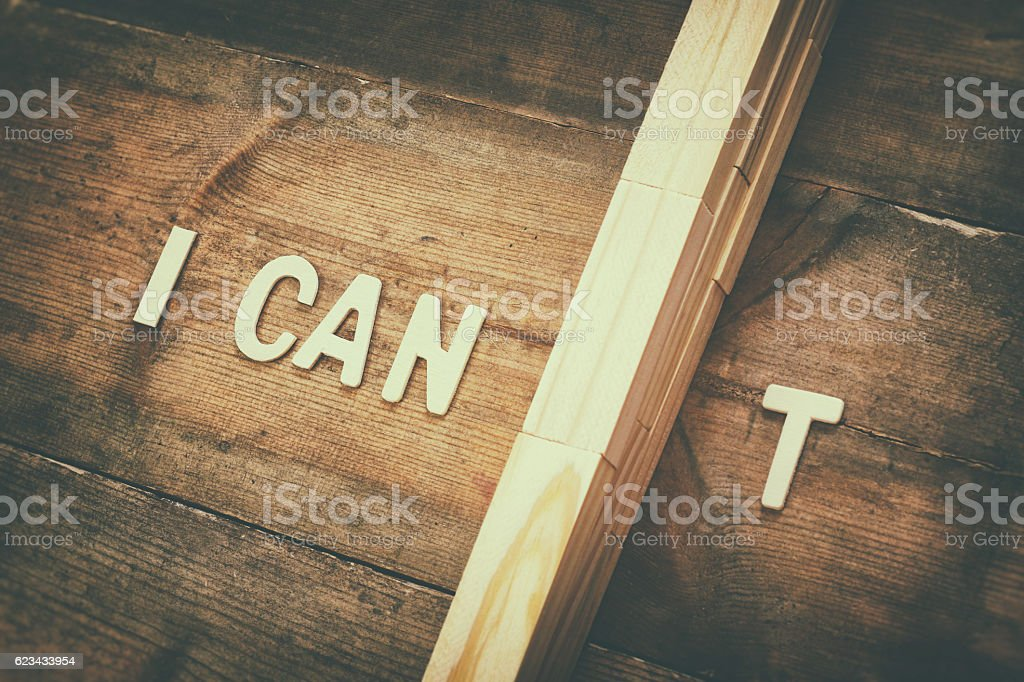 wall between letters I CAN'T. Success and challenge stock photo