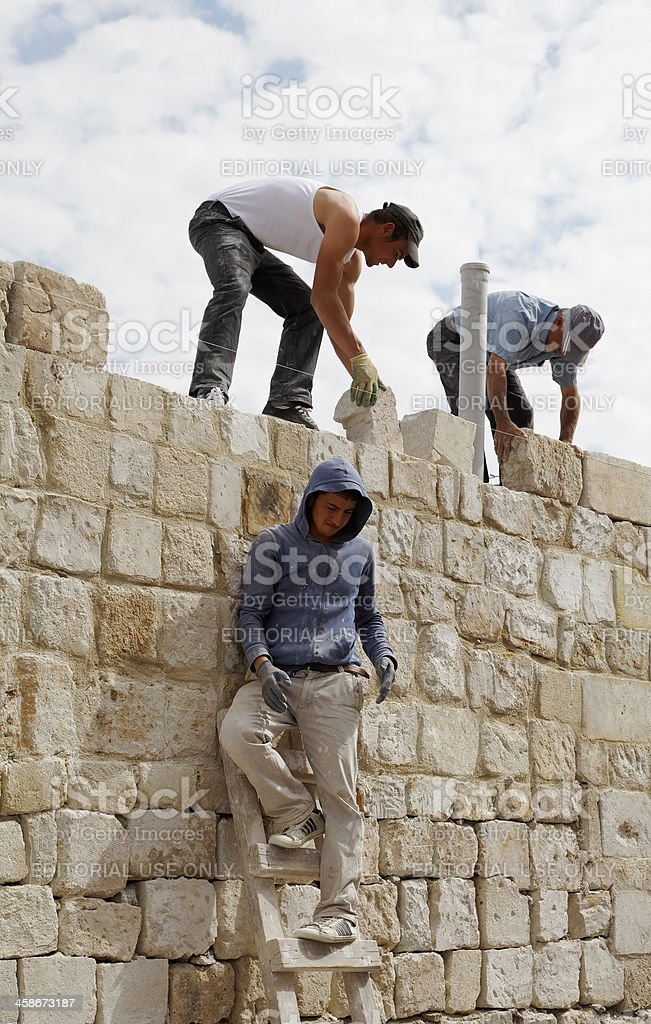 Wall building Turkish builders teamwork royalty-free stock photo