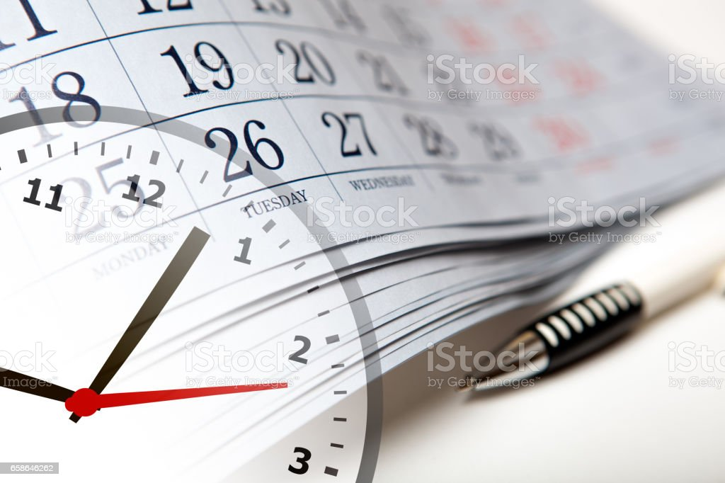 wall calendar calendar with the number of days and clock stock photo