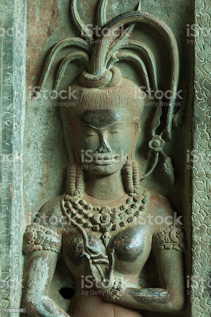 Wall carving at Angkor Wat, Cambodia royalty-free stock photo