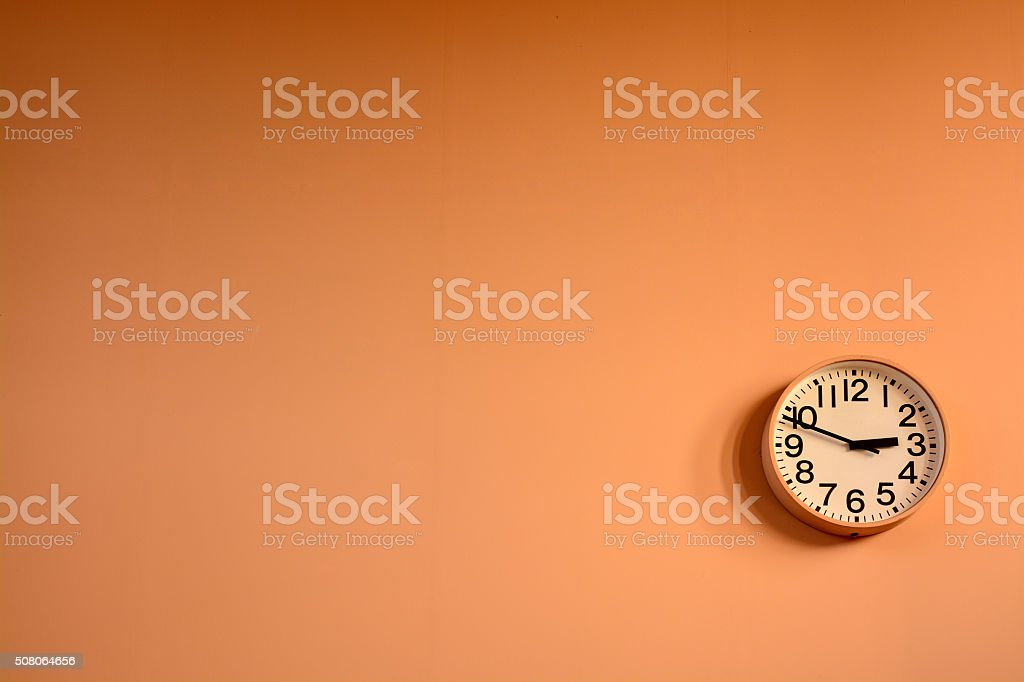 Wall clock on plain background. stock photo