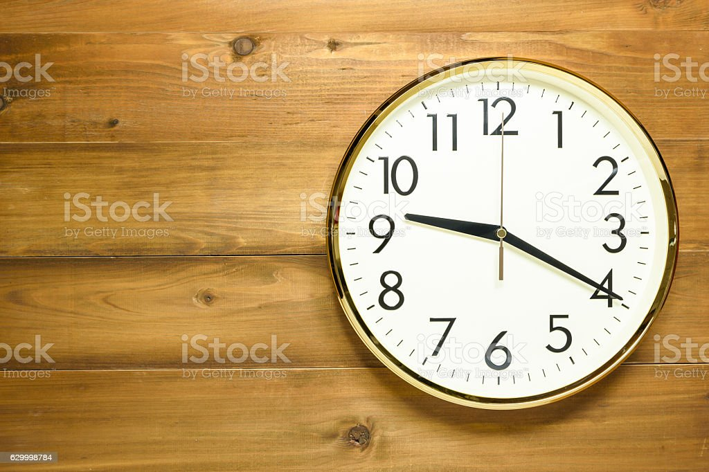 wall clock on the wooden wall stock photo
