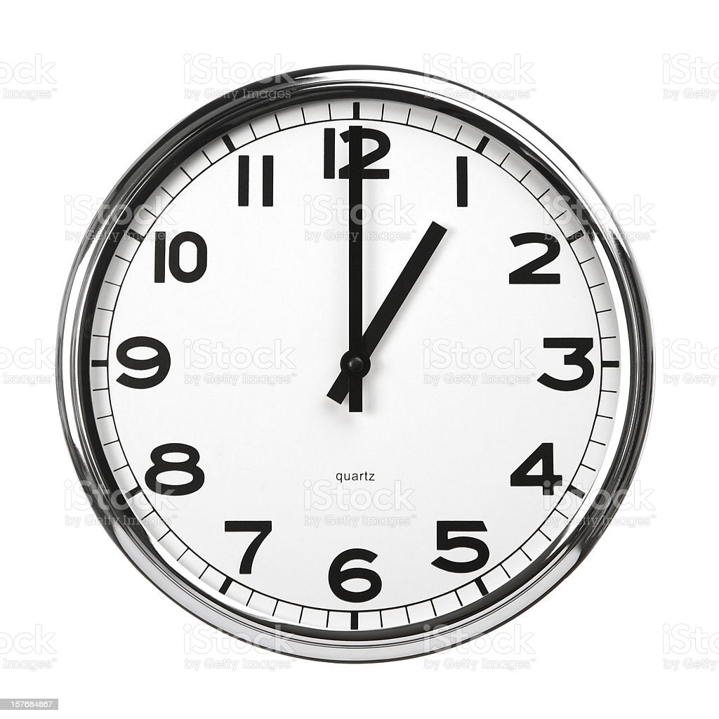 Wall clock with metal surround, hands read 1 o-clock royalty-free stock photo