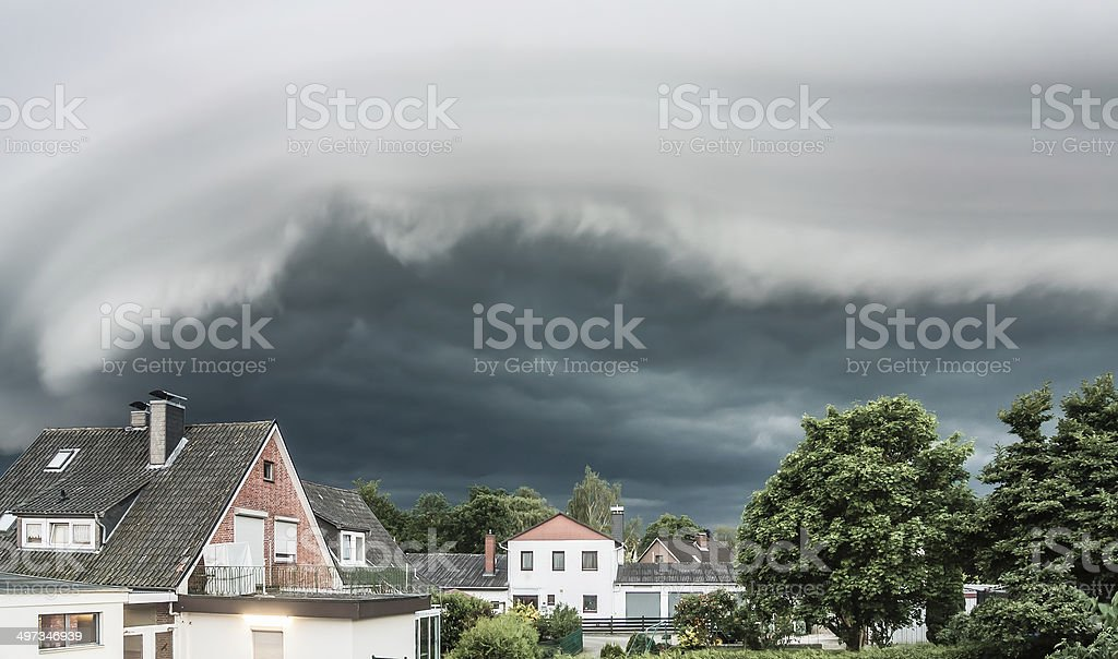 Wall cloud over village stock photo