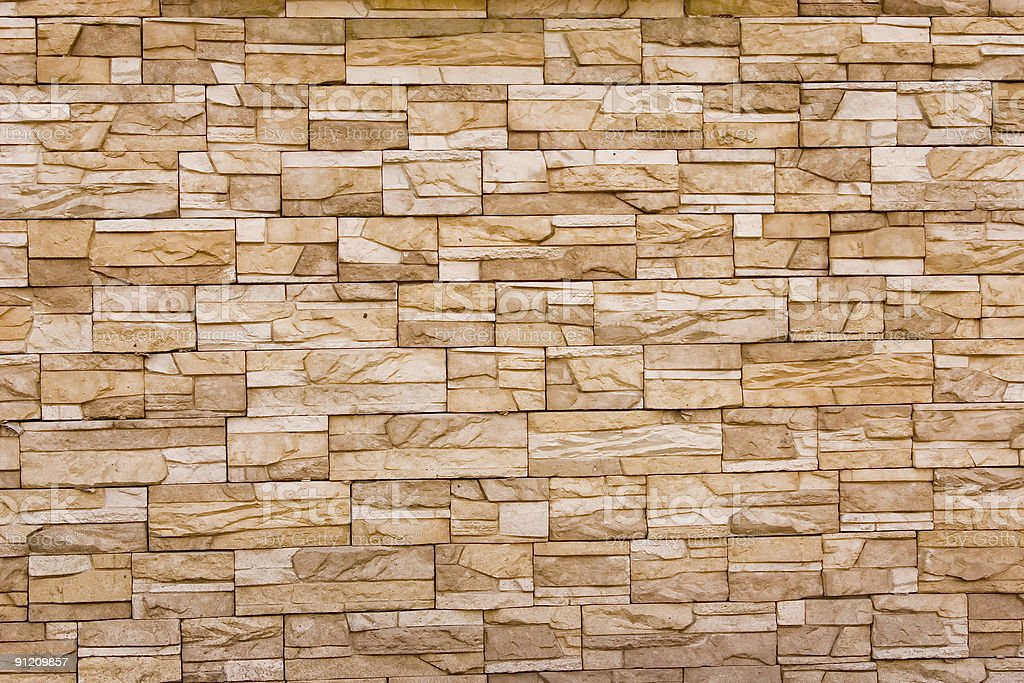 Wall constructed of stones. royalty-free stock photo