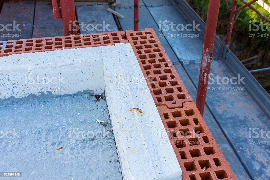 wall construction with insulation in construction site stock photo