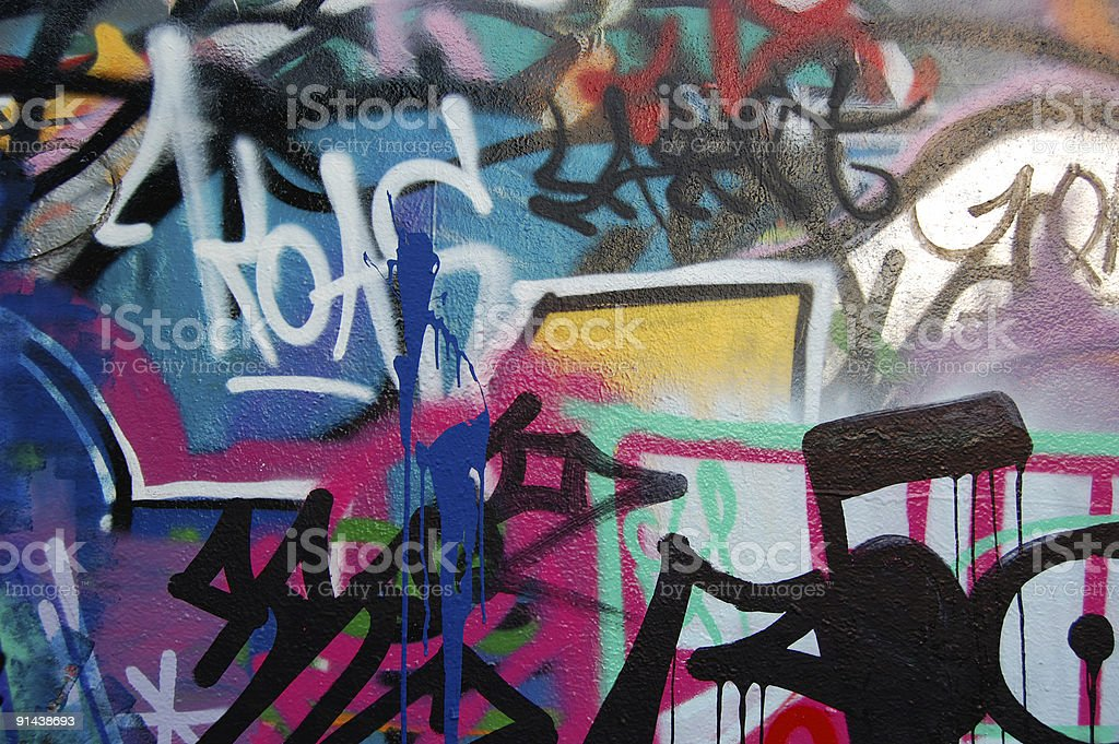 Wall covered in different color graffiti and writing on it stock photo
