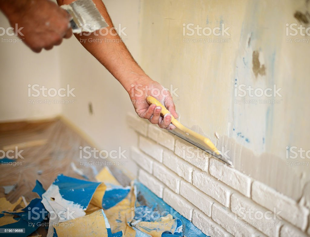 wall facing work with brick stock photo