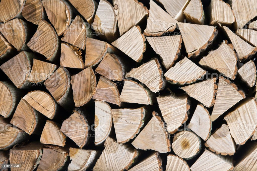 wall firewood , Background of dry chopped firewood logs stock photo