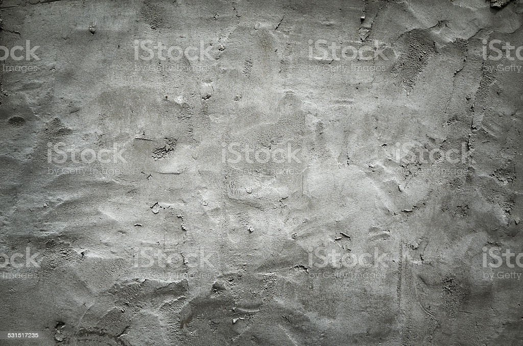 Gray spotted wall texture, concrete cement background.