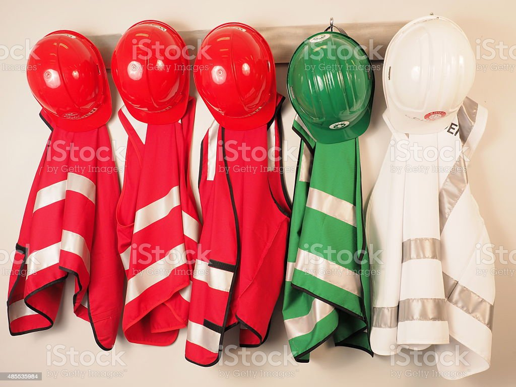 Wall hanger with vest and helmets  emergency warden team stock photo