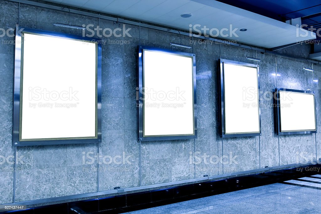 wall in museum with empty frames stock photo