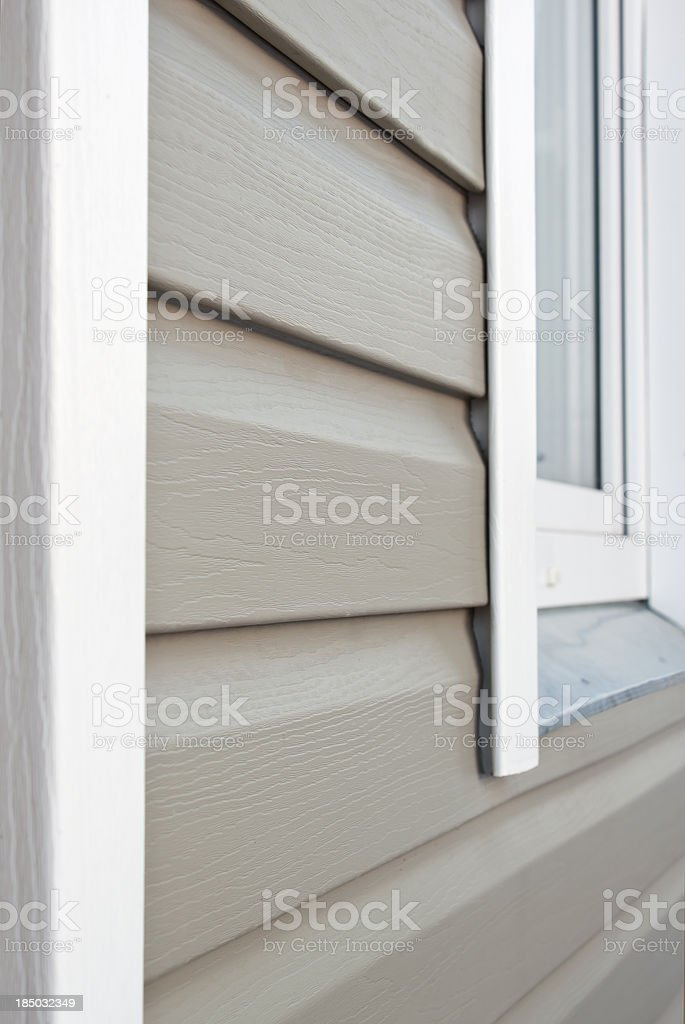 Wall is covered by vinyl siding stock photo