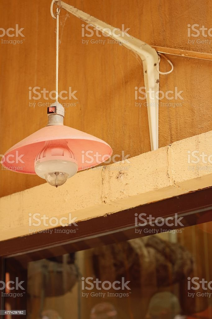 Wall lamp on an orange background at the park stock photo