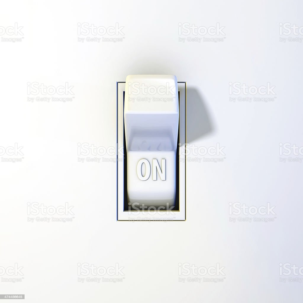 Wall light switch in the ON position stock photo