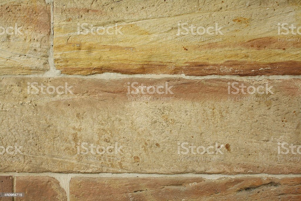 Wall made from sandstone bricks as background royalty-free stock photo