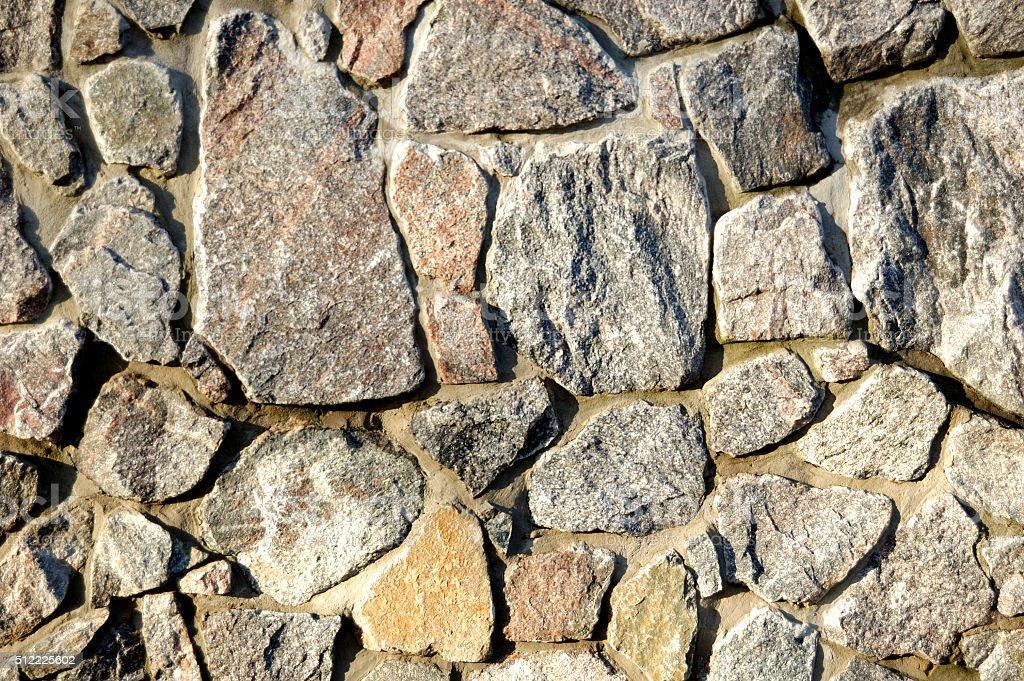 wall made of granite stock photo