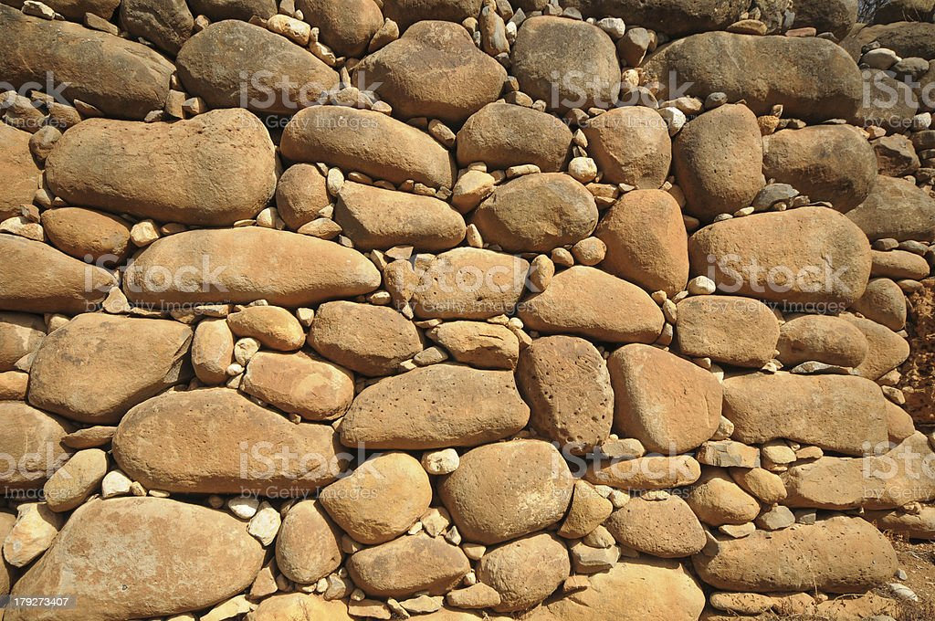 wall made of pebbles stock photo