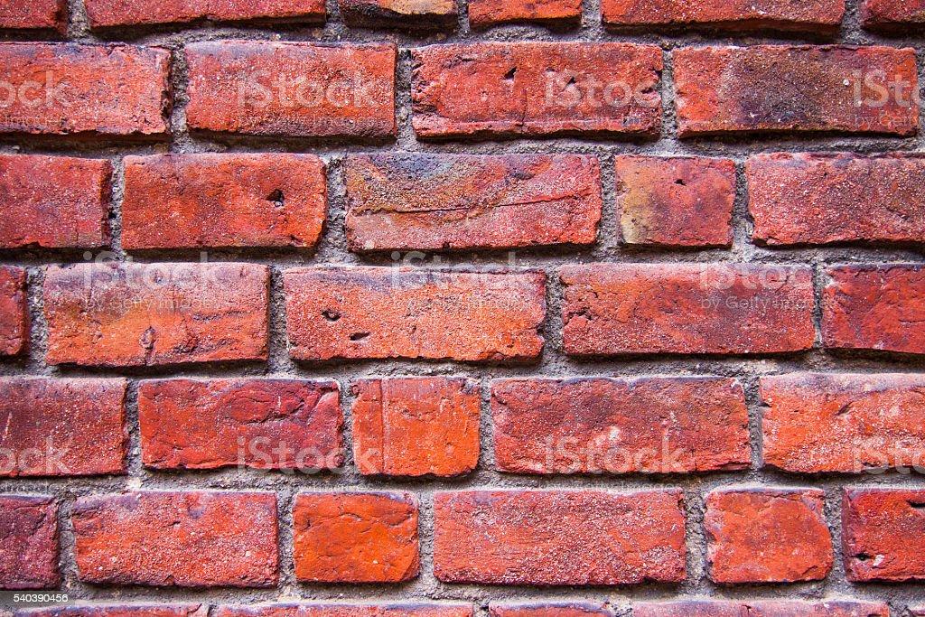 Wall made of red bricks stock photo