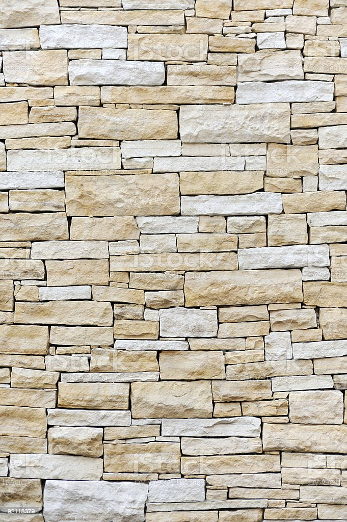 A wall made of sandstone bricks royalty-free stock photo