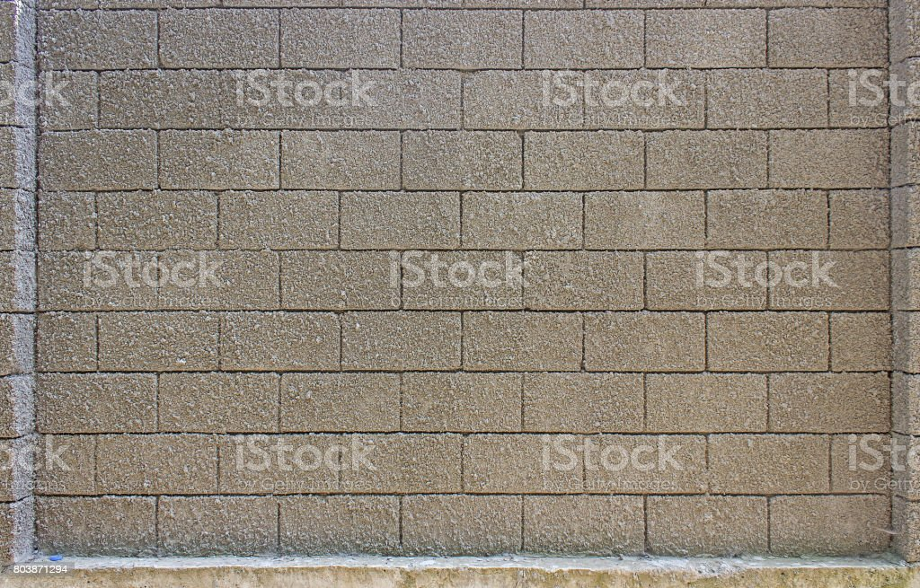 Wall made of stone blocks stock photo