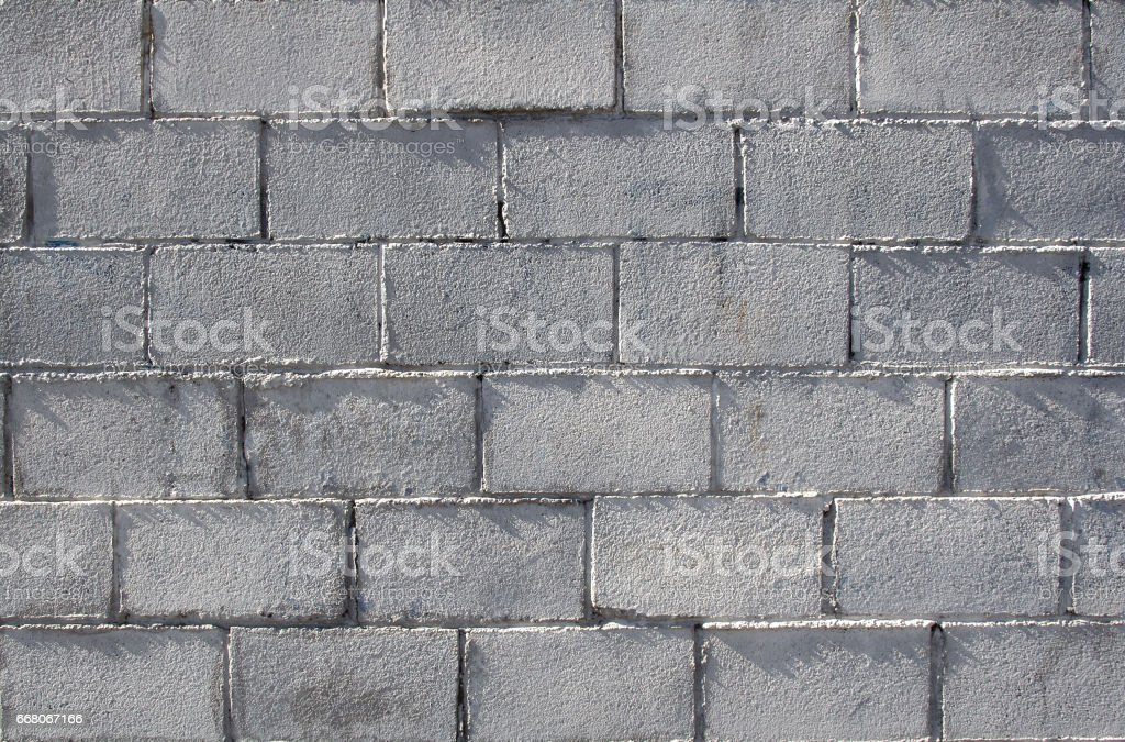 wall made ouf of concrete blocks in sunnyday stock photo