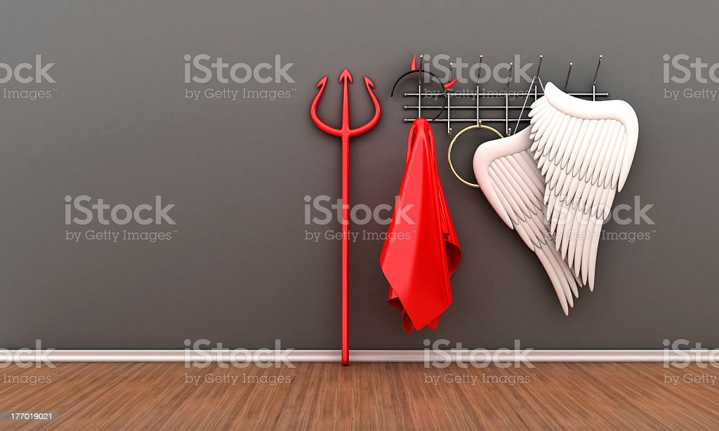 Wall mounted clothes hook with angel and devil costumes  stock photo