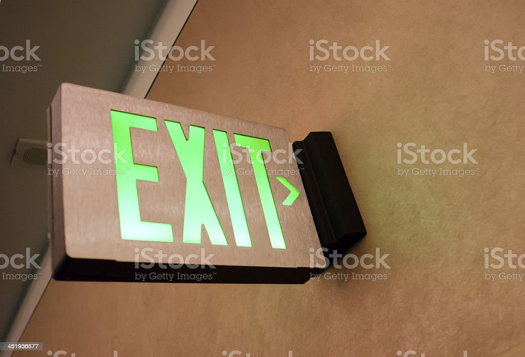 Wall Mounted Exit Sign Shows People Way Out Public Building stock photo