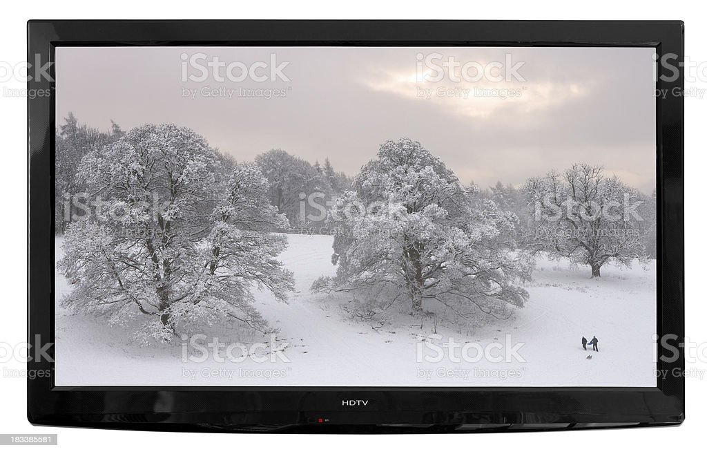wall mounted High Definition TV with winter scene stock photo