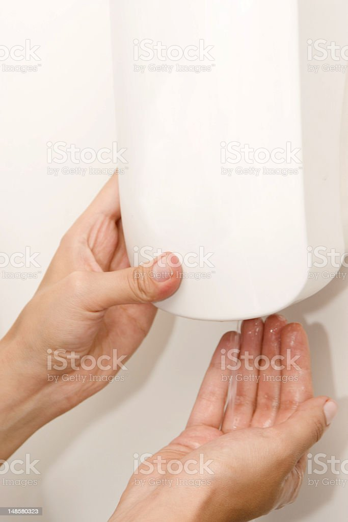 Wall Mounted Sanitizer Dispenser with Woman Hand stock photo