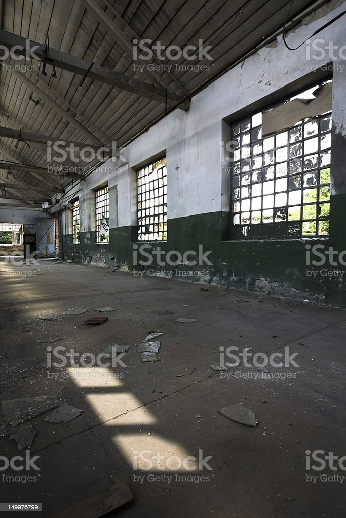 wall of an old factory hall royalty-free stock photo