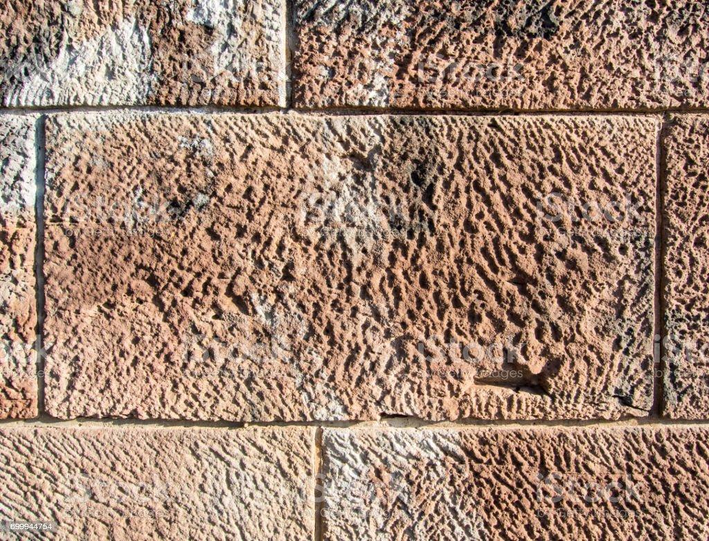 Wall of blocks of stone stock photo