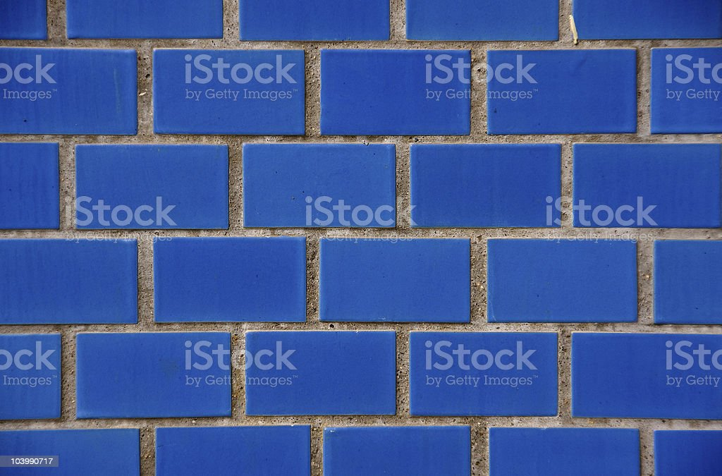 Wall of blue flaggings stock photo