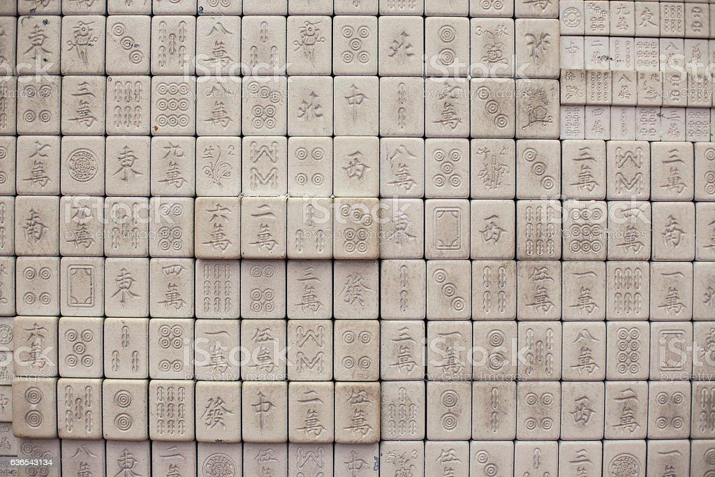 Wall of chinese characters on bricks stock photo