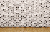 Wall of concrete hexagons and wooden floor