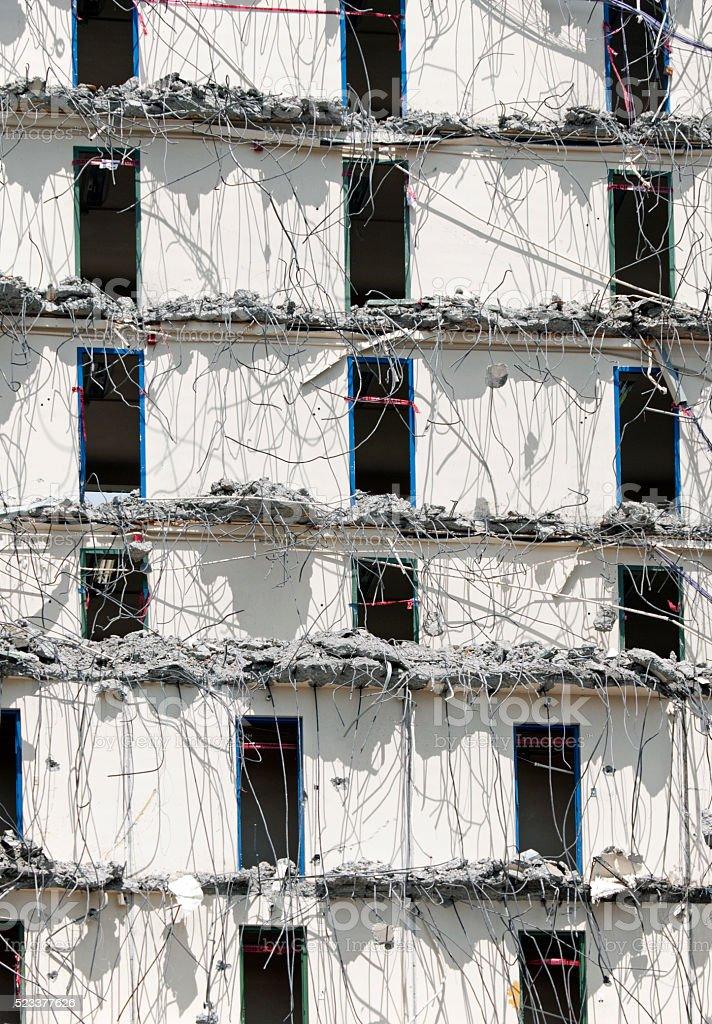 Wall of doorways in dormitory under demolition stock photo