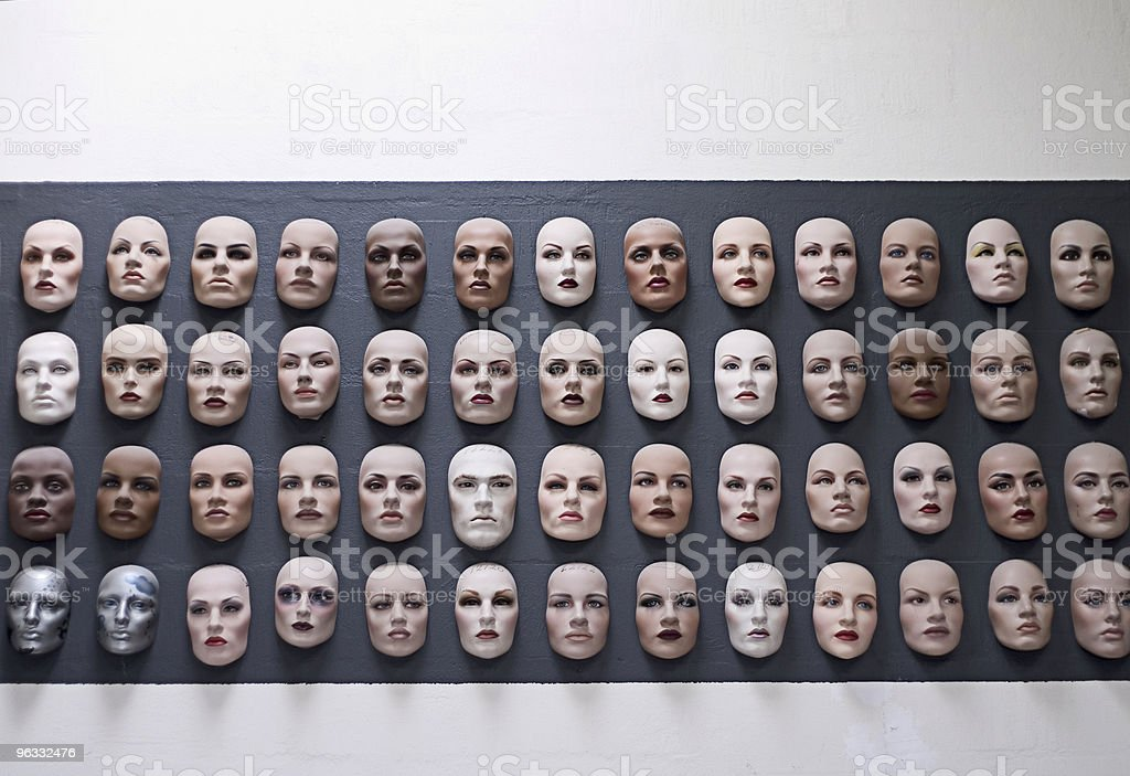 Wall of faces stock photo