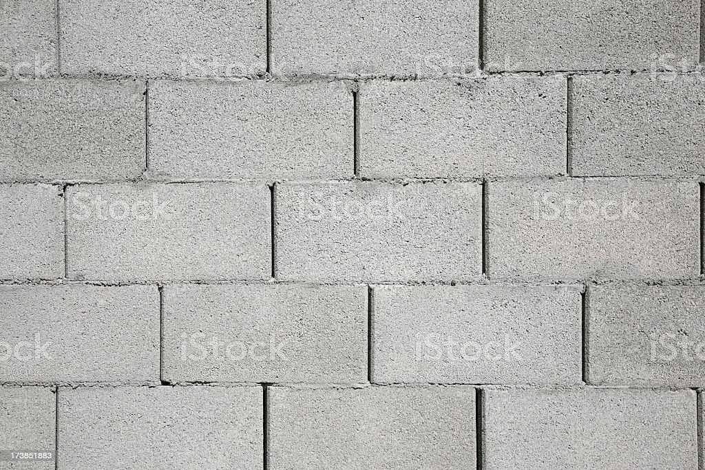 Wall of gray stacked cinder blocks stock photo