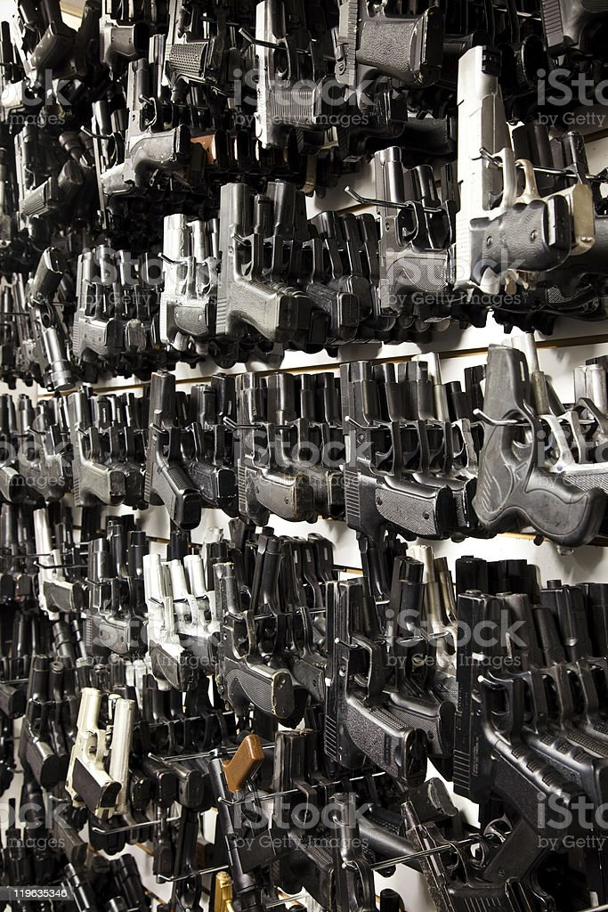 Wall of Guns! stock photo