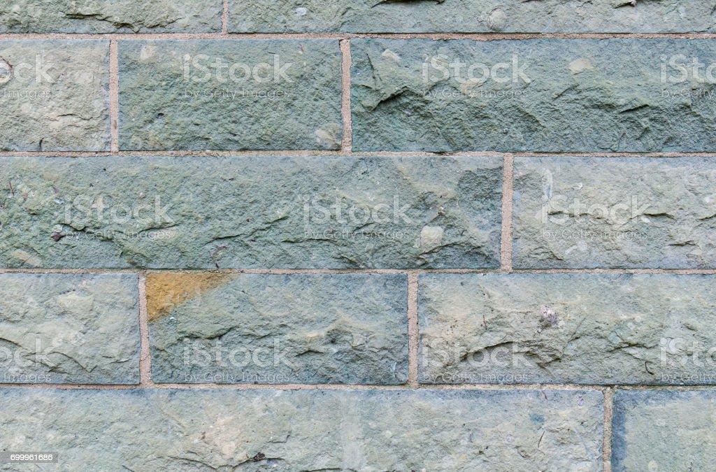 Wall of hewn stone stock photo