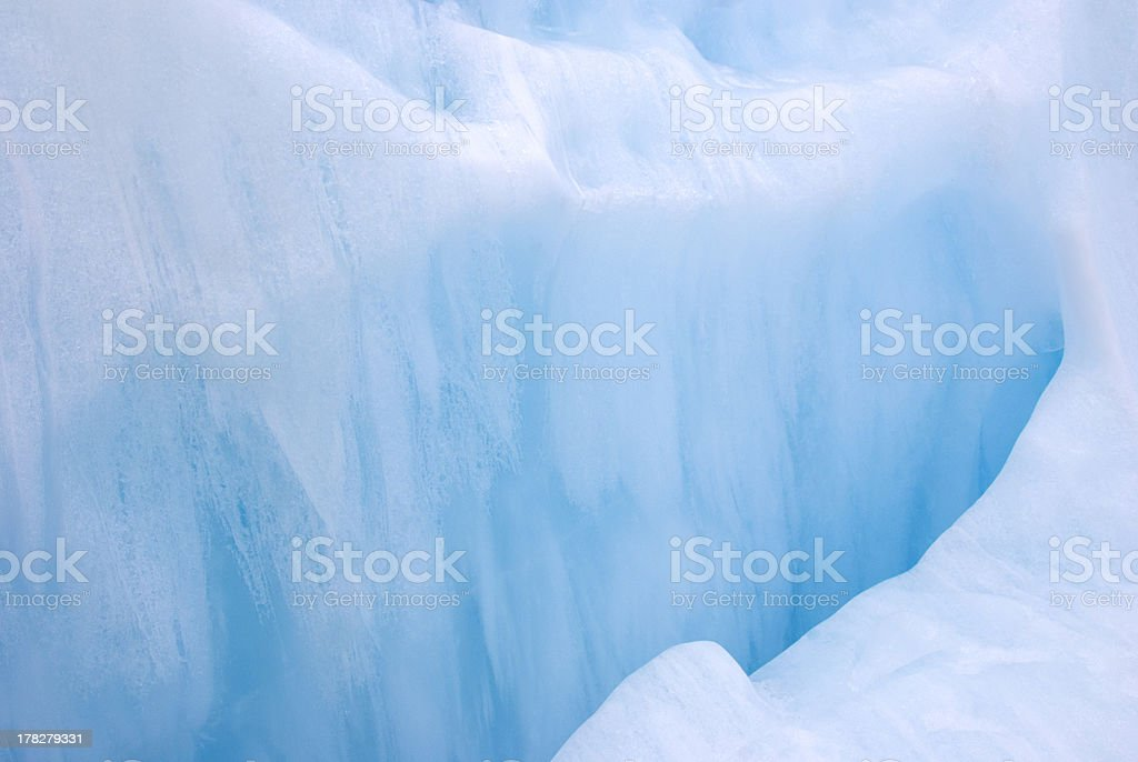 Wall of ice naturally caved into glacier royalty-free stock photo