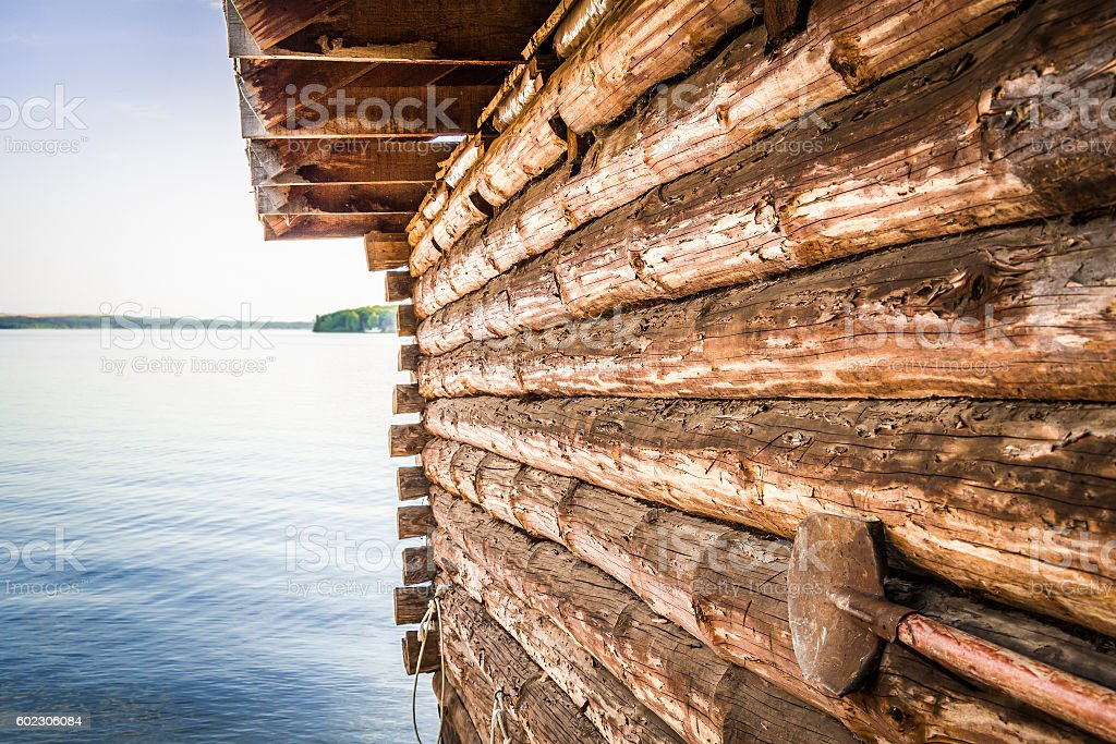 Wall of log house close-up. stock photo