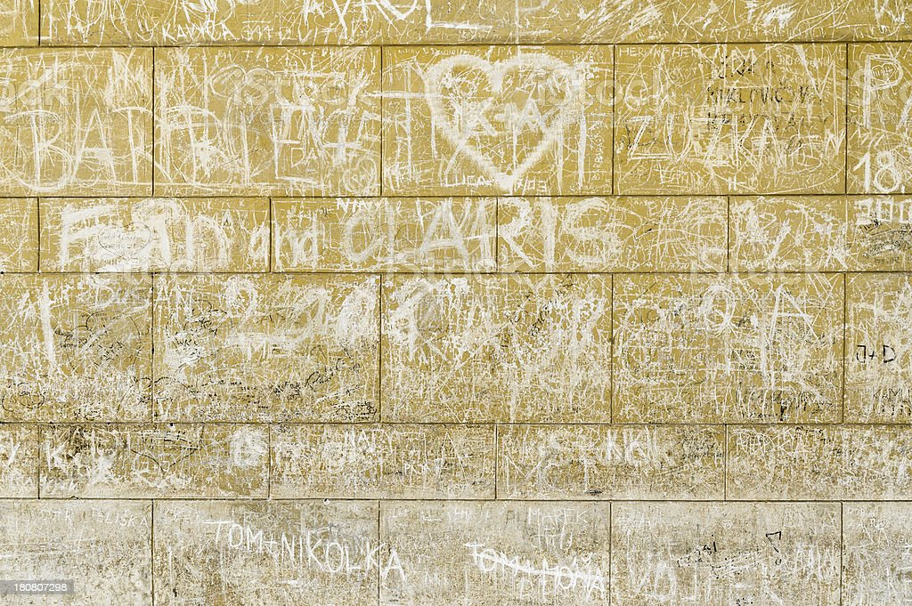Wall of love, drawings on an old stone sandy background royalty-free stock photo